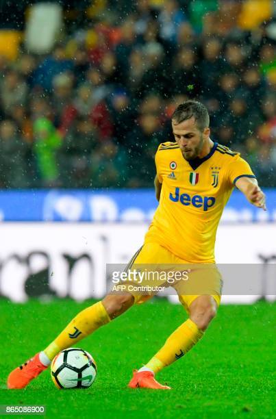 Juventus' Bosnian midfielder Miralem Pjanic controls the ball to shoot and score his team's sixth goal during the Italian Serie A football match...