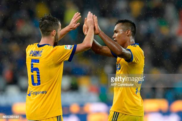 Juventus' Bosnian midfielder Miralem Pjanic is congratulated by Brazilian forward Douglas Costa de Souza as he celebrates after scoring his team's...