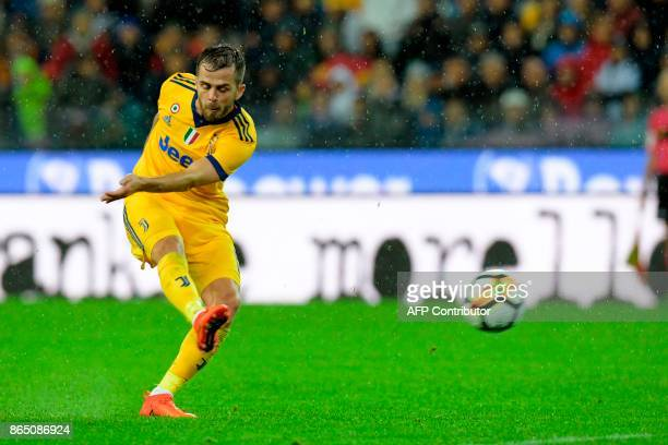 Juventus' Bosnian midfielder Miralem Pjanic shoots and score his team's sixth goal during the Italian Serie A football match Udinese vs Juventus at...