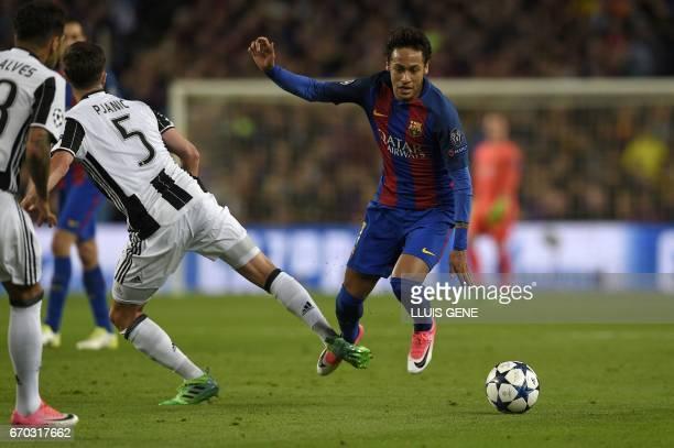 Juventus' Bosnian midfielder Miralem Pjanic vies with Barcelona's Brazilian forward Neymar during the UEFA Champions League quarterfinal second leg...