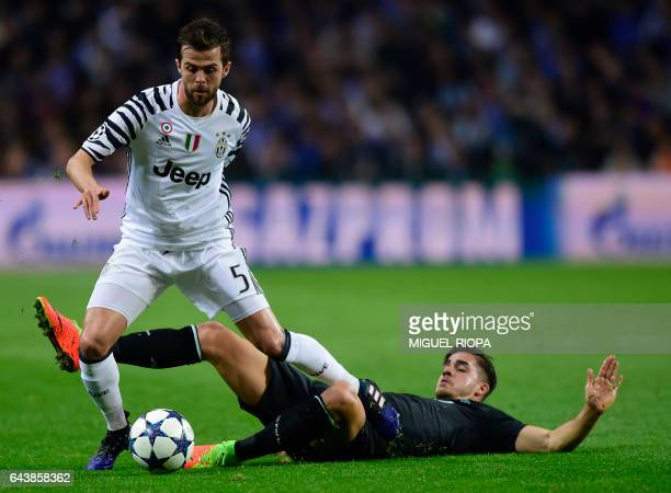 Juventus' Bosnian midfielder Miralem Pjanic vies with Porto's forward Andre Silva during the UEFA Champions League round of 16 second leg football...