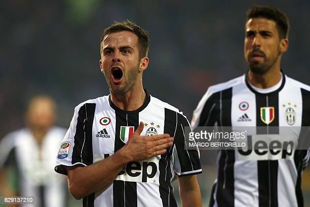 Juventus' BosnianErzegovinan midfielder Miralem Pjanic celebrates after scoring a goal during the Italian Serie A football match between Torino and...