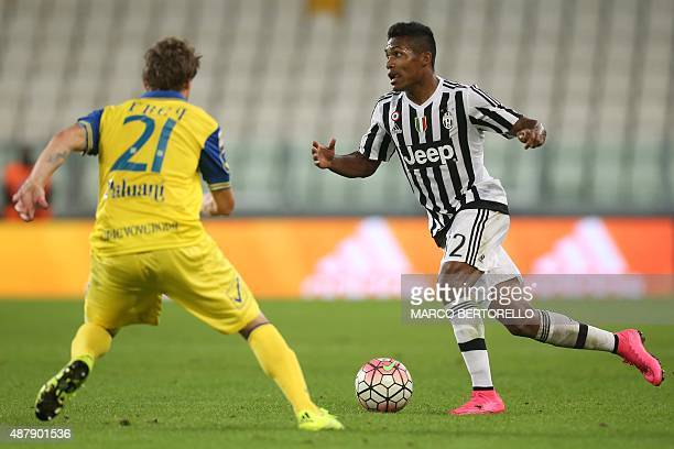 Juventus' Brazilian defender Alex Sandro controls the ball during the Italian Serie A football match between Juventus and Chievo on September 12 2015...