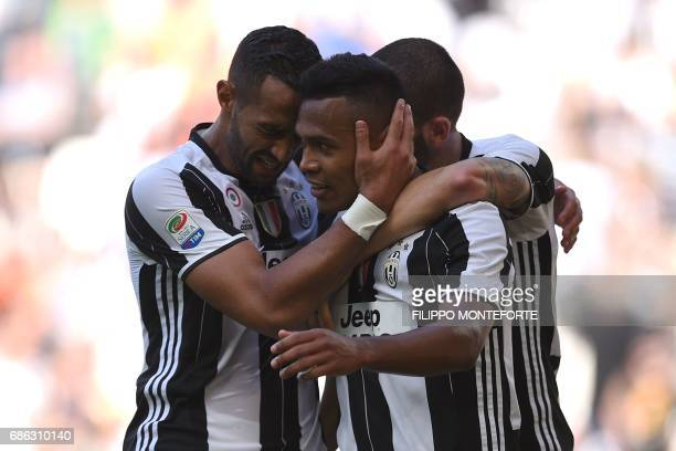Juventus' Brazilian defender Alex Sandro Lobo Silva celebrates with teammate Juventus' defender Medhi Benatia after scoring during the Italian Serie...