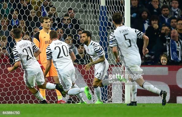 TOPSHOT Juventus' Brazilian defender Dani Alves celebrates after scoring a goal during the UEFA Champions League round of 16 second leg football...