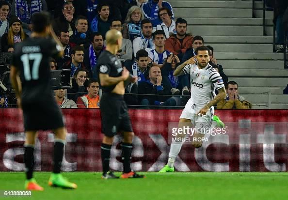 Juventus' Brazilian defender Dani Alves celebrates after scoring a goal during the UEFA Champions League round of 16 second leg football match FC...