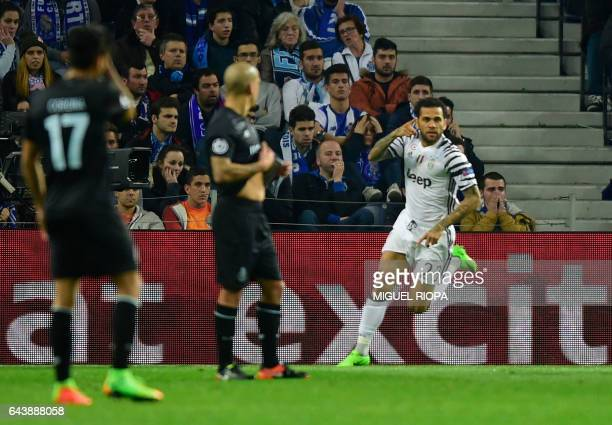 Juventus' Brazilian defender Dani Alves celebrates after scoring a goal during the UEFA Champions League round of 16 second leg football match FC...