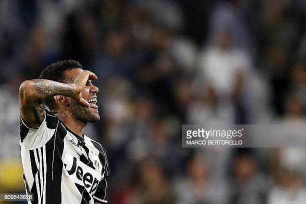 Juventus' Brazilian defender Dani Alves celebrates after scoring during the Italian Serie A football match between Juventus and Cagliari on September...