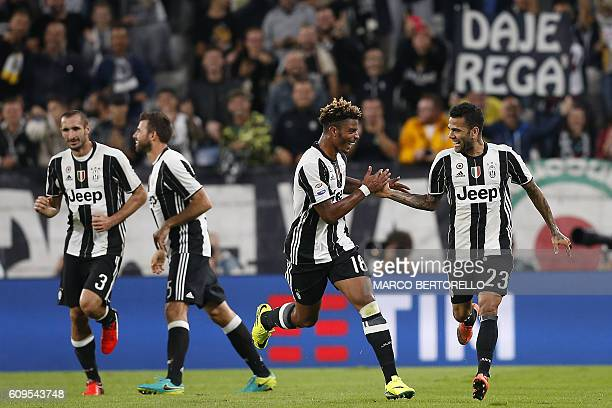 Juventus' Brazilian defender Dani Alves celebrates with teammate Juventus' French defender Mario Lemina after scoring during the Italian Serie A...
