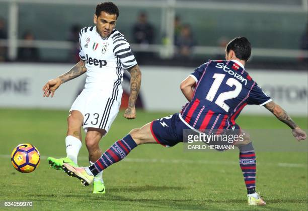 Juventus' Brazilian defender Dani Alves fights for the ball with Crotone's Romanian midfielder Adrian Stoian during the Italian Serie A football...