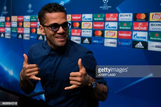Juventus' Brazilian defender Dani Alves gestures during a press conference at the Camp Nou stadium in Barcelona on April 18 2017 on the eve of the...