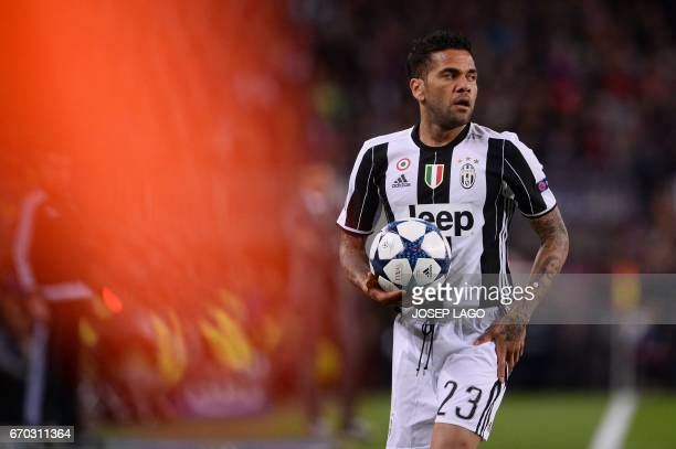 Juventus' Brazilian defender Dani Alves holds the ball during the UEFA Champions League quarterfinal second leg football match FC Barcelona vs...