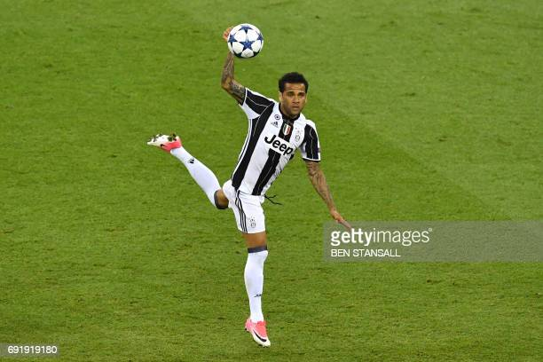TOPSHOT Juventus' Brazilian defender Dani Alves jumps during the UEFA Champions League final football match between Juventus and Real Madrid at The...