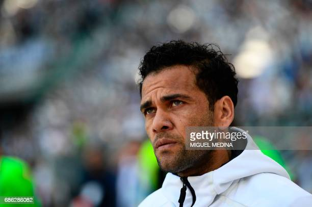 Juventus' Brazilian defender Daniel Alves da Silva looks on before the Italian Serie A football match Juventus vs Crotone at the Juventus Stadium in...
