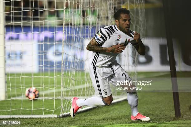 Juventus' Brazilian defender Daniel Alvez da Silva celebrates after scoring during the Italian Serie A football match Atalanta vs Juventus at the...