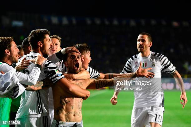 Juventus' Brazilian defender Daniel Alvez da Silva celebrates with teammates after scoring during the Italian Serie A football match Atalanta vs...