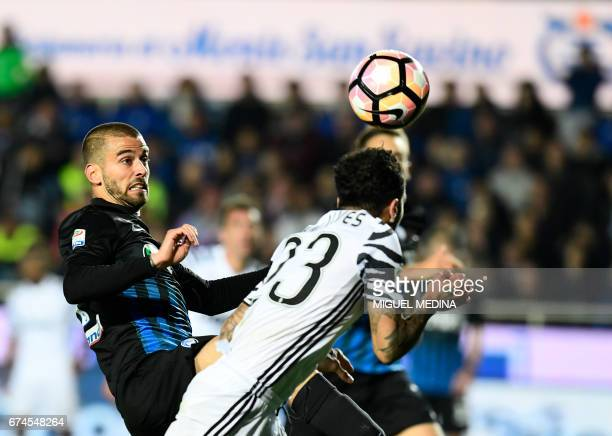 Juventus' Brazilian defender Daniel Alvez da Silva heads the ball and scores during the Italian Serie A football match Atalanta vs Juventus at the...