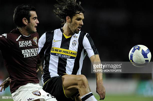 Juventus Brazilian forward Amauri Carvalho de Oliveira fights for the ball with Torino's defender Riccardo Colombo during their city derby Series A...
