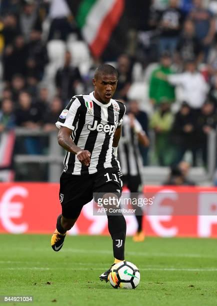 Juventu's Brazilian forward Douglas Costa de Souza controls the ball during the Italian Serie A football match Juventus vs Chievo at the Allianz...