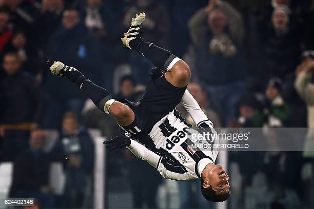 TOPSHOT Juventus' Brazilian midfielder Anderson Hernanes celebrates after scoring a goal during the Italian Serie A football match between Juventus...