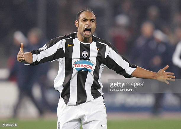 Juventus' Brazilian midfielder Emerson celebrates after Marcelo Zalayeta scored against Real Madrid during their Champions League 2nd leg football...