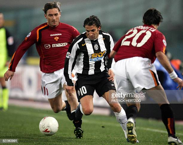 Juventus' captain Alessandro Del Piero vies with AS Roma's captain Francesco Totti during their serie A football match at the Olympic stadium in Rome...