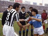 Juventus captain Antonio Cabrini greets Napoli captain Diego Maradona to exchange pennants before a league match in Turin 17th April 1988 Juventus...