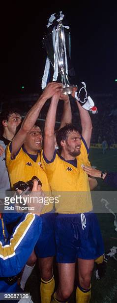Juventus captain Gaetano Scirea with Marco Tardelli celebrate with the trophy after the Juventus v Porto European Cup Winners Cup Final played at the...