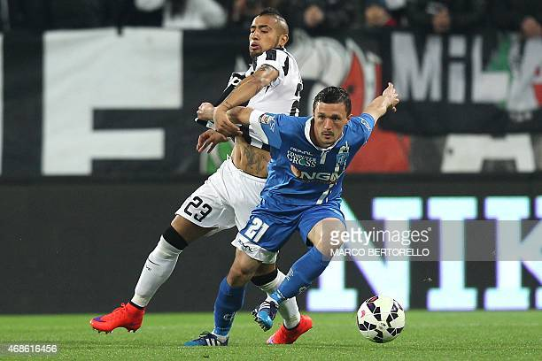 Juventus' Chilean midfielder Arturo Pardo Vidal fights for the ball with Empoli's defender Mario Rui of Portugal during the Italian Serie A football...