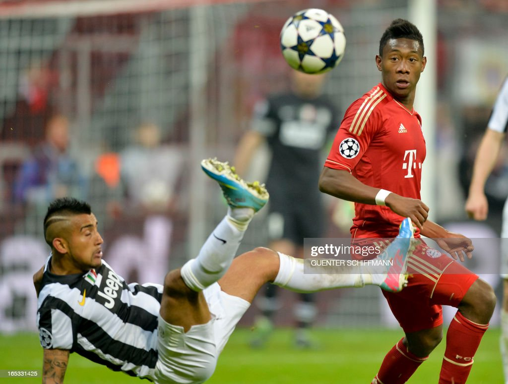 Juventus' Chilean midfielder Arturo Vidal (L) and Bayern Munich's Austrian midfielder David Alaba vie for the ball during the UEFA Champions League quarter final football match FC Bayern Munich vs Juventus Turin in Munich, southern Germany, on April 2, 2013. Bayern Munich won the match 2-0.