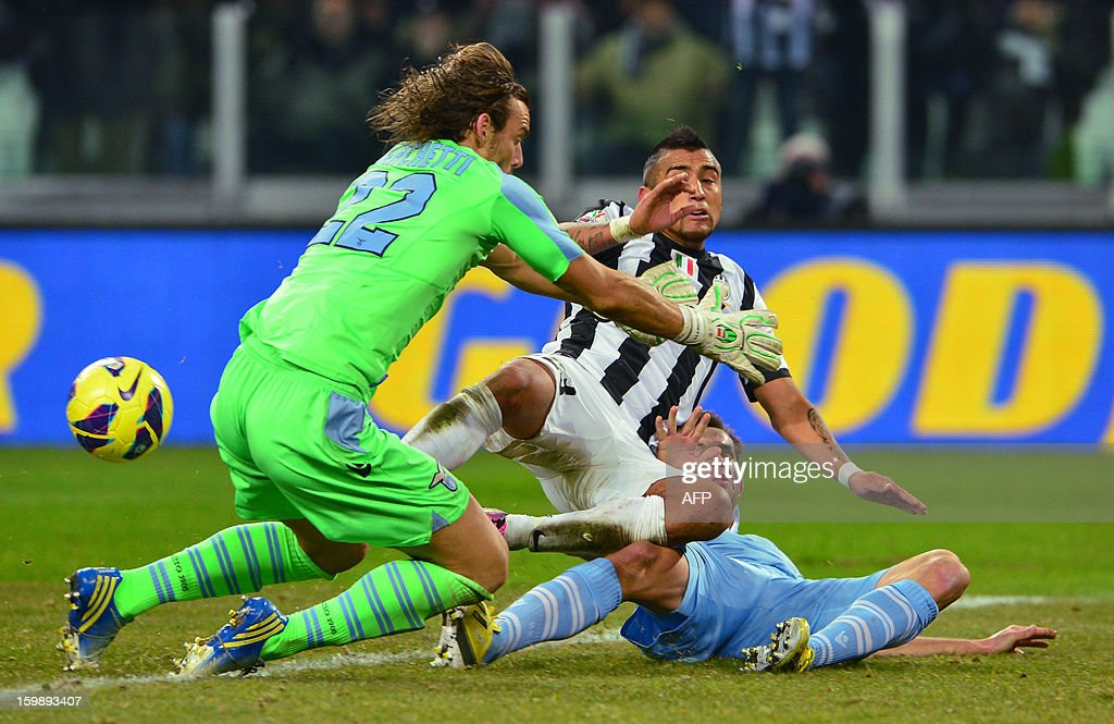 Juventus' Chilean midfielder Arturo Vidal (C) vies with Lazio's goalkeeper Federico Marchetti and Lazio's defender Senad Lilic of Bosnia and Herzegovina during their TIM CUP football match at the Juventus Stadium in Turin on January 22, 2013.