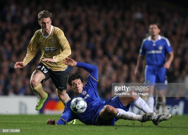 Juventus' Claudio Marchisio and Chelsea's Michael Ballack battle for the ball