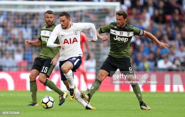 Juventus' Claudio Marchisio steps on the leg of Tottenham Hotspur's Vincent Janssen as they battle for the ball during the preseason friendly match...