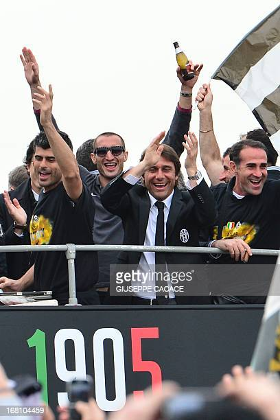 Juventus' coach Antonio Conte celebrate with his players in a bus with supporters after defeating Palermo to win the Scudetto the Italian Serie A...