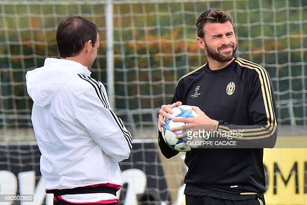 Juventus' coach from Italy Massimiliano Allegri and Juventus' defender from Italy Leonardo Bonucci attend a training session on the eve of the UEFA...