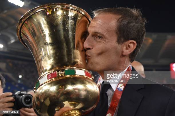 Juventus' coach from Italy Massimiliano Allegri kisses the trophy after winning the Italian Tim Cup final football match AC Milan vs Juventus on May...