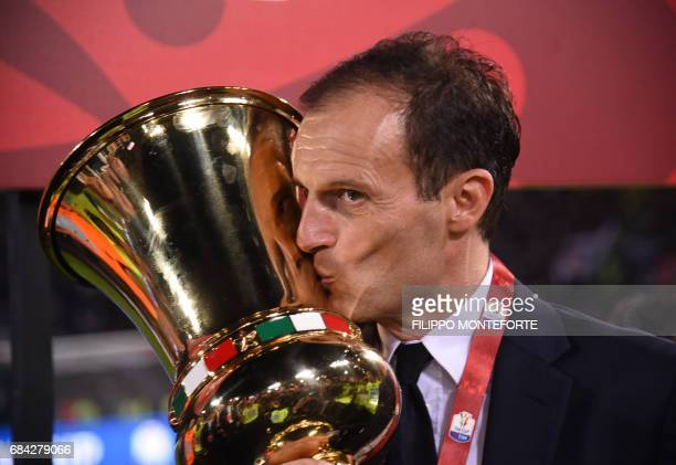 Juventus' coach from Italy Massimiliano Allegri kisses the trophy after winning the Italian Tim Cup final on May 17 2017 at the Olympic stadium in...