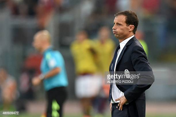 Juventus' coach from Italy Massimiliano Allegri reacts after AS Roma's second goal during the Italian Serie A football match AS Roma vs Juventus on...