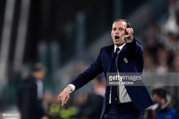 Juventus' coach from Italy Massimiliano Allegri reacts during the UEFA Champions League semi final second leg football match Juventus vs Monaco on...