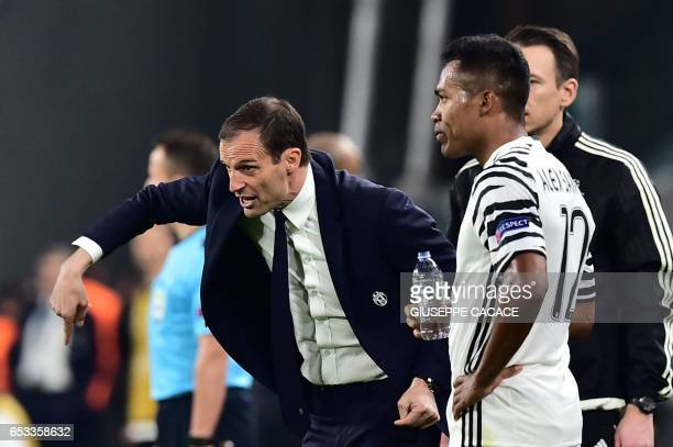 Juventus' coach from Italy Massimiliano Allegri reacts next to Juventus' defender from Brazil Alex Sandro during the UEFA Champions League football...