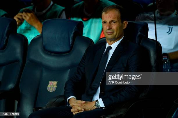 Juventus' coach from Italy Massimiliano Allegri waits before the UEFA Champions League Group D football match FC Barcelona vs Juventus at the Camp...