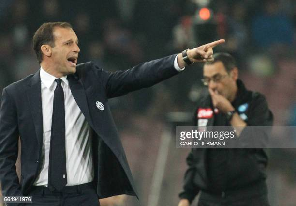 Juventus' coach fromy Italy Massimiliano Allegri reacts next to Napoli's Italian coach Maurizo Sarri during the Tim Cup semifinal second leg football...