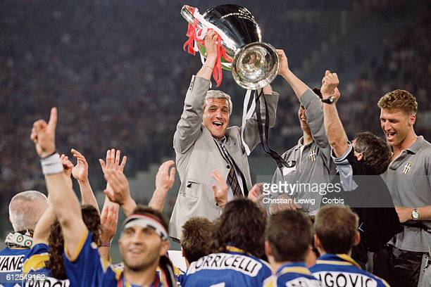 Juventus coach Marcello Lippi holds the trophy after his team won the 1996 UEFA Champions League final against Ajax Amsterdam 11 42
