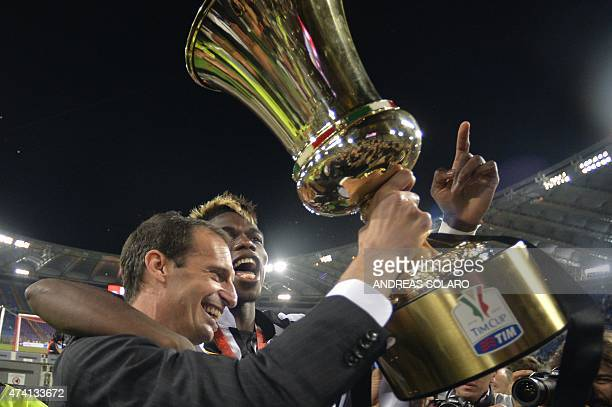 Juventus' coach Massimiliano Allegri and Juventus' midfielder from France Paul Pogba celebrate with the trophy after winning 21 the Italian Tim Cup...
