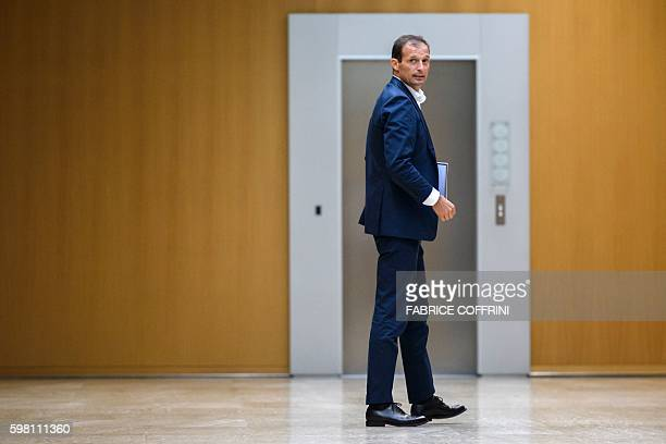 Juventus' coach Massimiliano Allegri looks on as he leaves a meeting of the Elite football Club Coaches Forum at the UEFA headquarters in Nyon on...