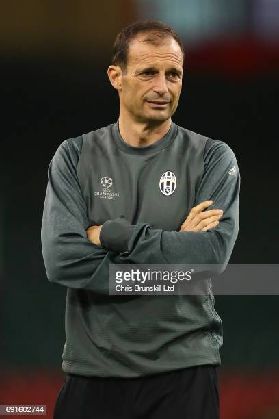Juventus coach Massimiliano Allegri looks on during a Juventus training session ahead of the UEFA Champions League Final at the National Stadium of...