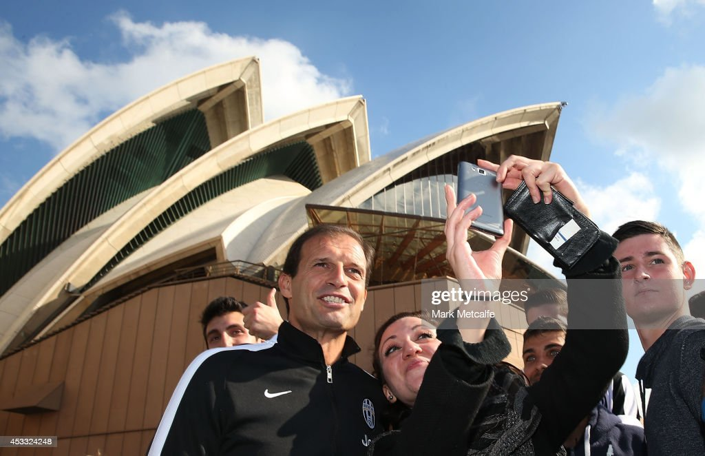 Juventus Coach <a gi-track='captionPersonalityLinkClicked' href=/galleries/search?phrase=Massimiliano+Allegri&family=editorial&specificpeople=3470667 ng-click='$event.stopPropagation()'>Massimiliano Allegri</a> poses for photos with fans in front of the Sydney Opera House during the Juventus media conference at Sydney Opera House on August 8, 2014 in Sydney, Australia.