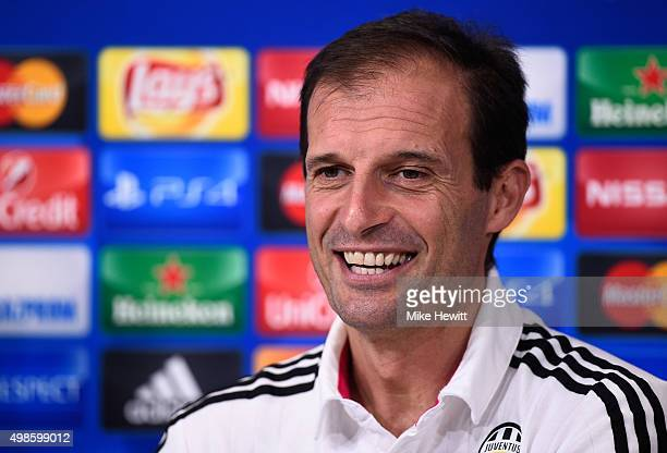 Juventus coach Massimiliano Allegri smiles during a Juventus press conference ahead of the UEFA Champions League match against Manchester City at...