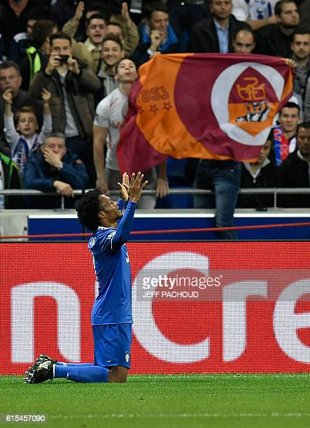 Juventus' Colombian forward Juan Cuadrado celebrates after scoring a goal during the Champions League football match between Olympique Lyonnais and...
