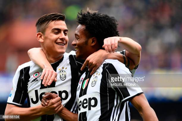 Juventus' Colombian forward Juan Cuadrado celebrates with Juventus' Argentinian forward Paulo Dybala after scoring a goal during the Italian Serie A...